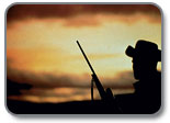 silhouetteof hunter with sun setting in background
