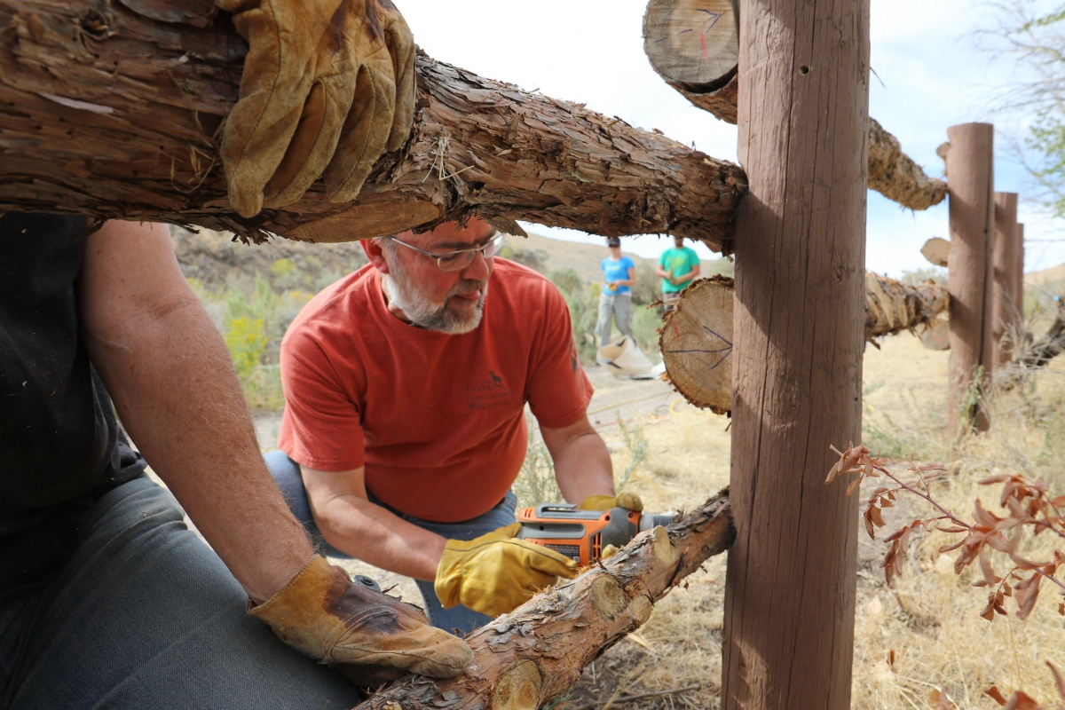 A volunteer builds a fence at a BLM Idaho National Public Lands Day event.