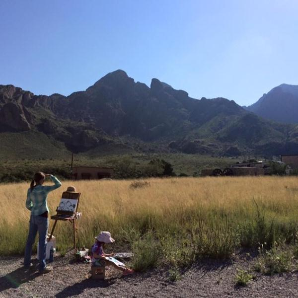 Along with a young budding artist, Meg Freyermuth paints the beautiful Organ Mountains as its first Artist-in-Residence. Photo by Daniella Barraza, Student Conservation Association Intern.