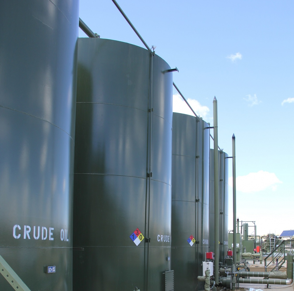 Row of crude oil containers. BLM photo