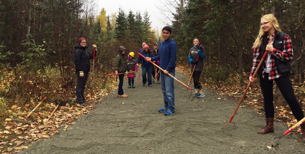 Volunteers smoothing gravel on trail in Campbell Tract, Alaska