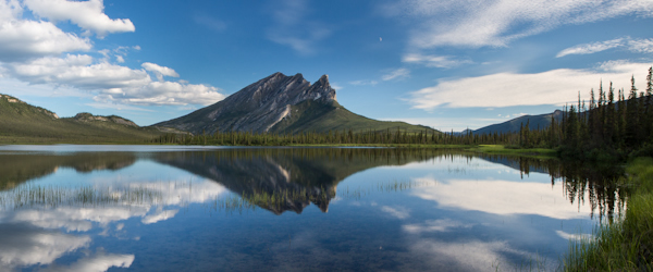 Sukakpak Mountain and its reflection in a clear blue lake on summer day along the Dalton Highway cooridor