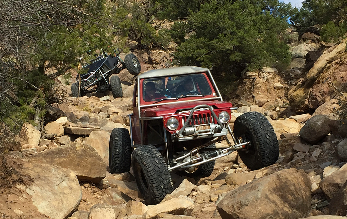 Two rock crawlers navigate over the rocks in Coyote Canyon, Moab.