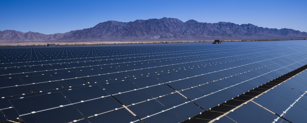 Mountain view of solar facility in the California desert.  Photo by Tom Brewster Photography.
