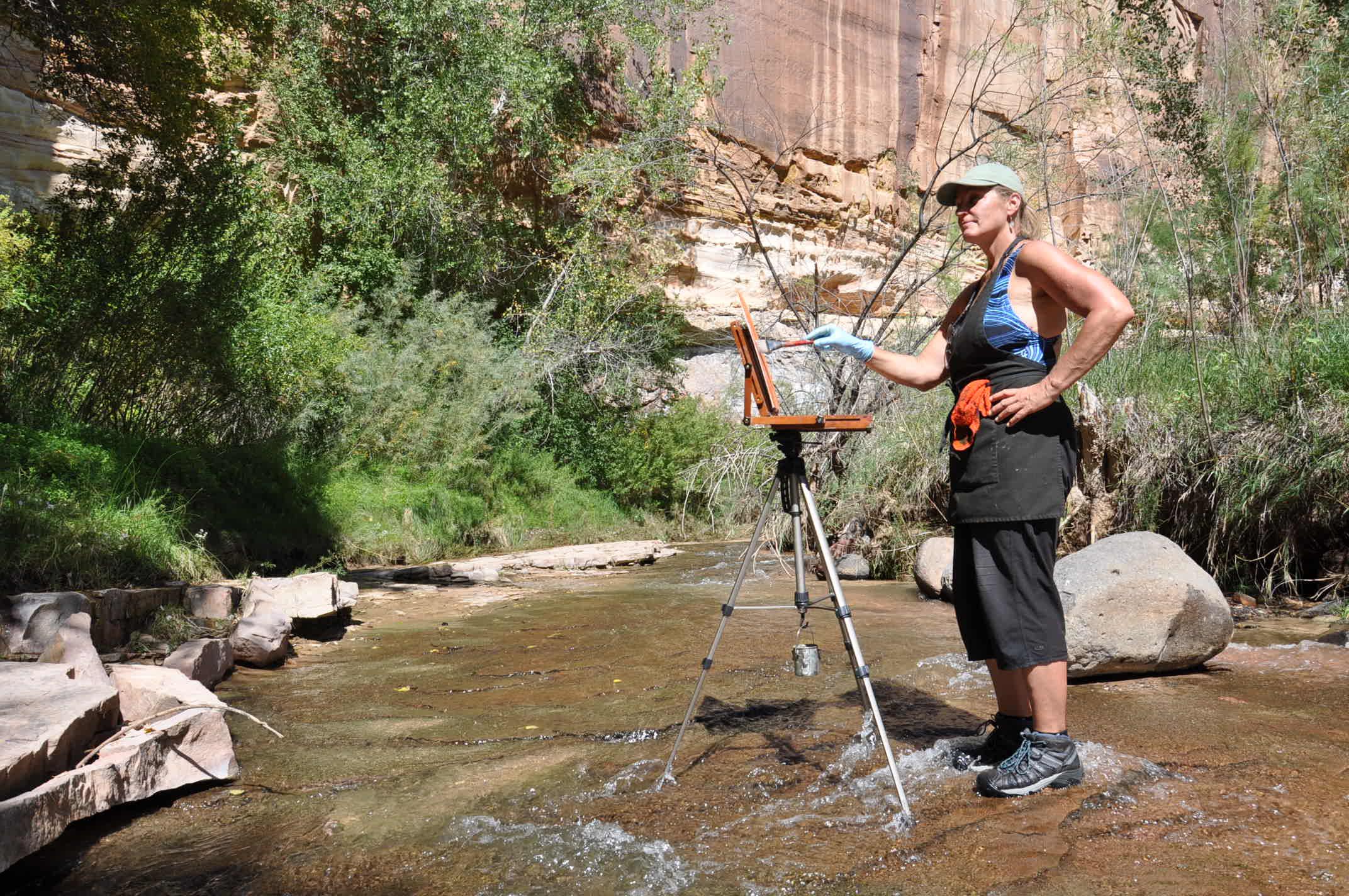 Artist Loretta Domaszewski paints along the Escalante River.