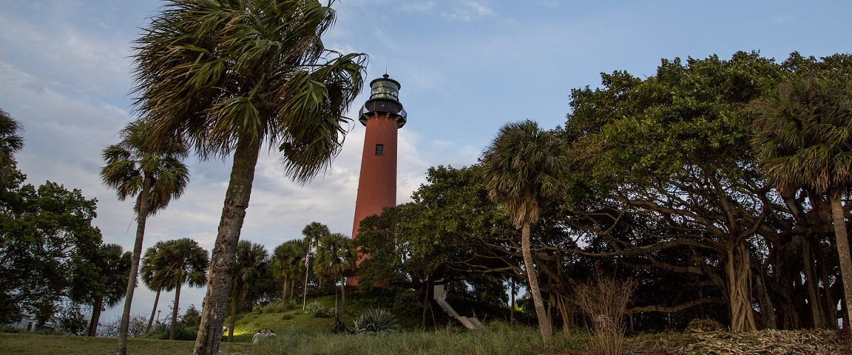 Three people observing the natural environment surrounding Jupiter Inlet Outstanding Natural Area. Photo by Bob Wick.