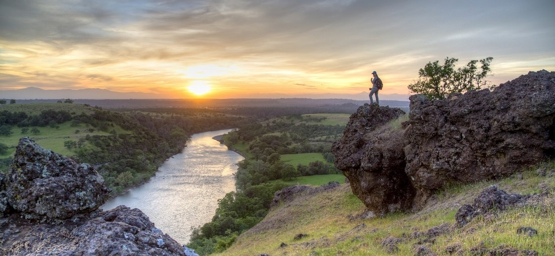 A woman view the sunset over Sacramento River Bend Outstanding Natural Area. Photo by Bob Wick, BLM
