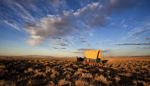 Covered wagon travels the Oregon-California-Pony Express Historic Trail, Wyoming, photo by Bob Wick, BLM