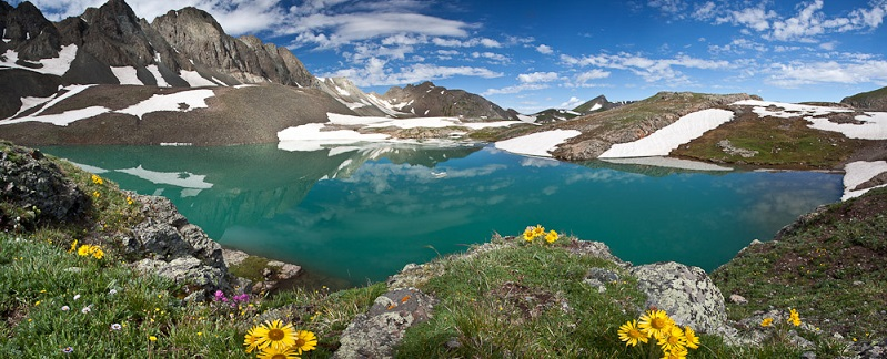 A beautiful view of mountains, flowers, and a lake in Handies Peak Wilderness Study Area in Colorado. Photo by Bob Wick.