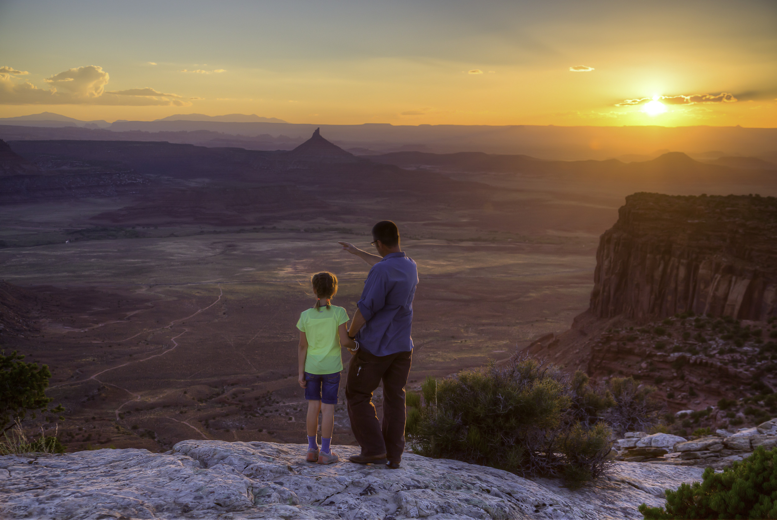 A father and daughter watch the sunset over Indian Creek in Utah. Photo by Bob Wick, BLM.