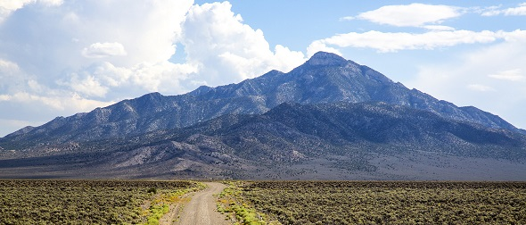 A landscape view of a road leading to a mountain in Basin and Range National Monument. Photo by Bob Wick, BLM.