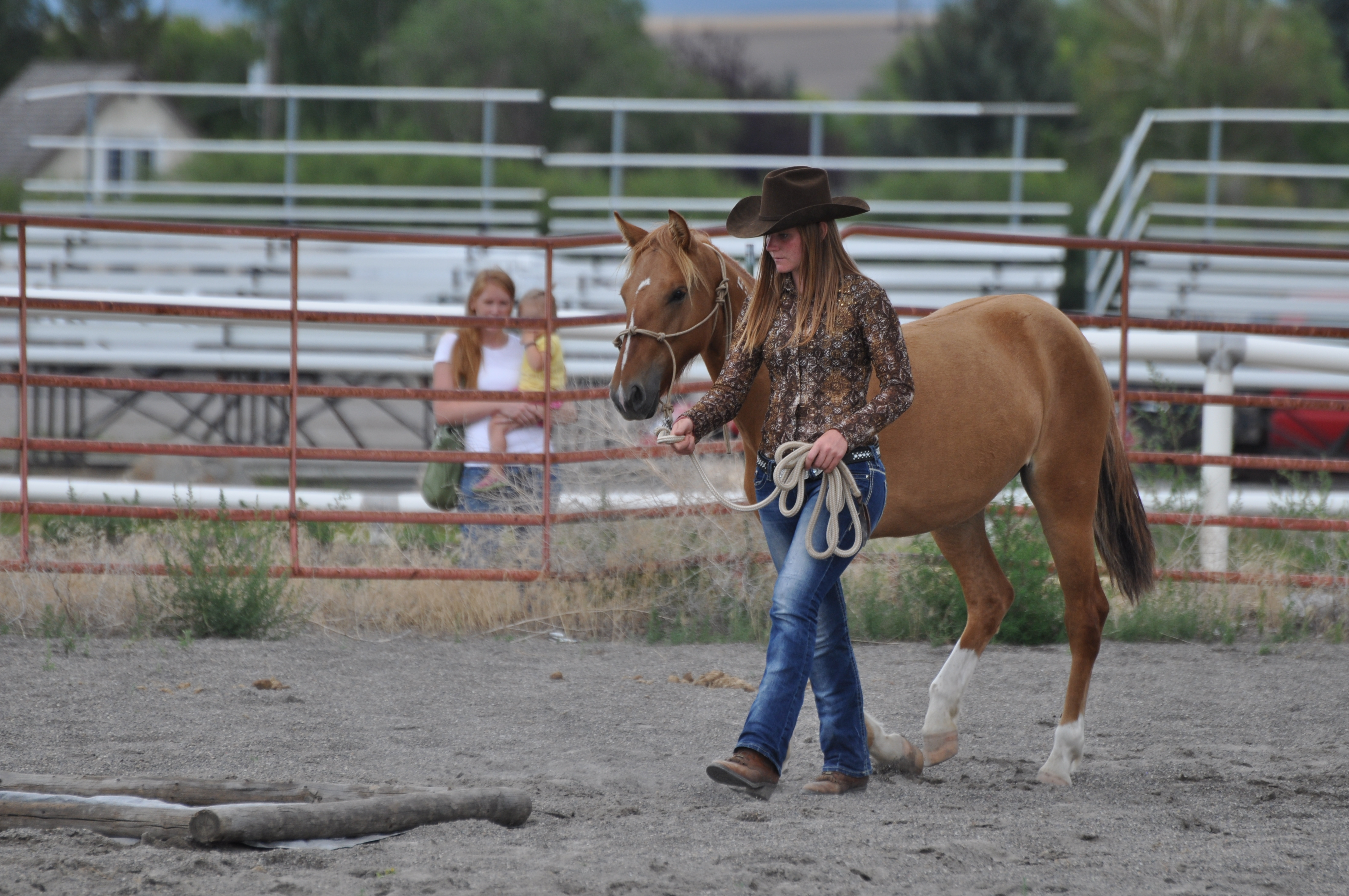 An Idaho 4-H member demonstrates the progress she's made with the mustang she gentled  as part of the partnership with BLM.