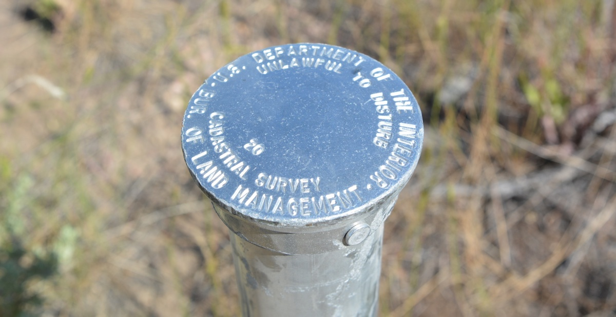 A close up of a survey pin. BLM photo.