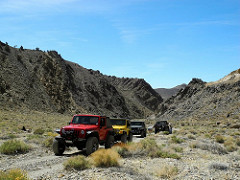 Jeeps on a dirt road in a mountain area. Photo courtesy of U.S. Forest Service.
