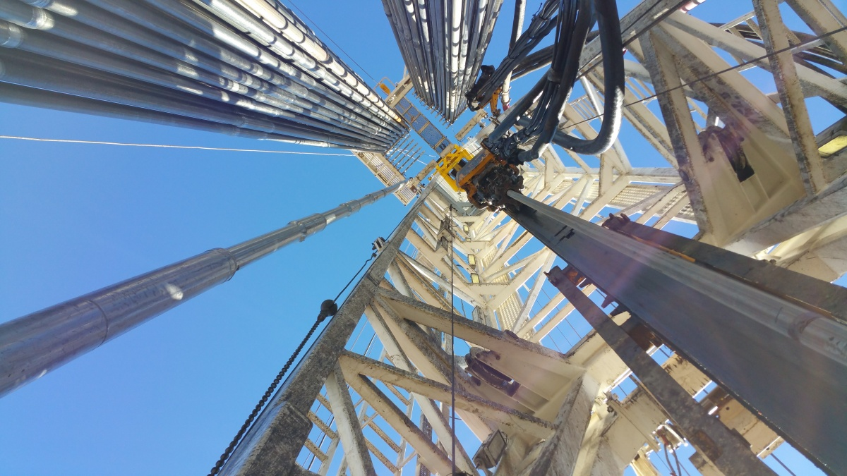 View looking up from the center of a drilling rig. Photo by Victoria Barr.
