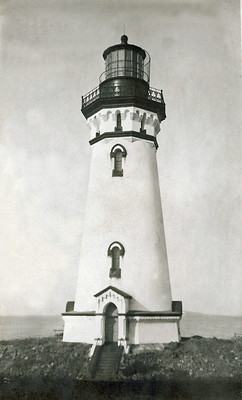 An old photo of a victorian light house.