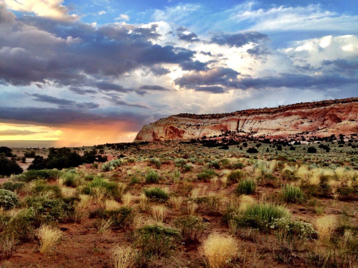 scenic view of grand staircase escalante with clouds over landscape