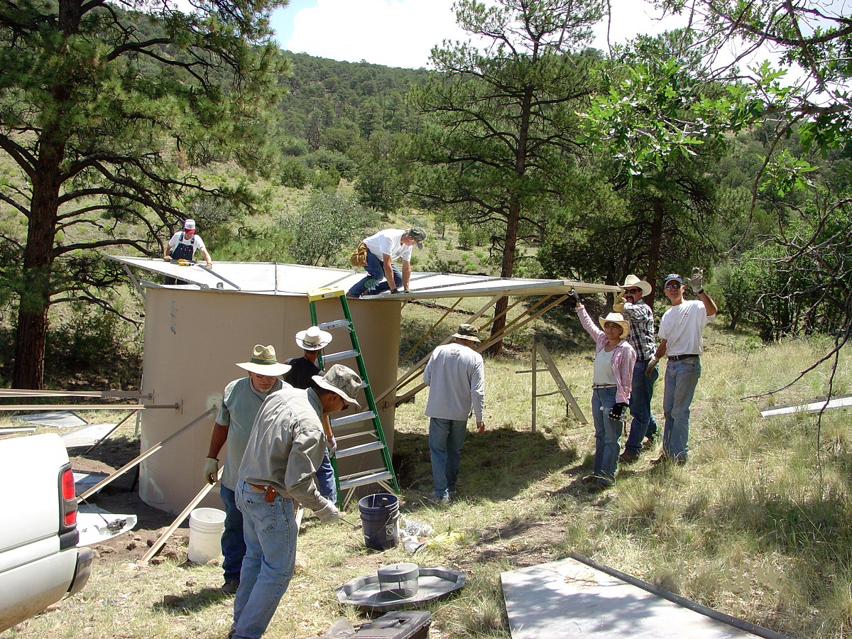 The BLM working with the New Mexico Department of Game and Fish, National Wild Turkey Federation, and members of the public constructing a watering unit near Palona Mountain.