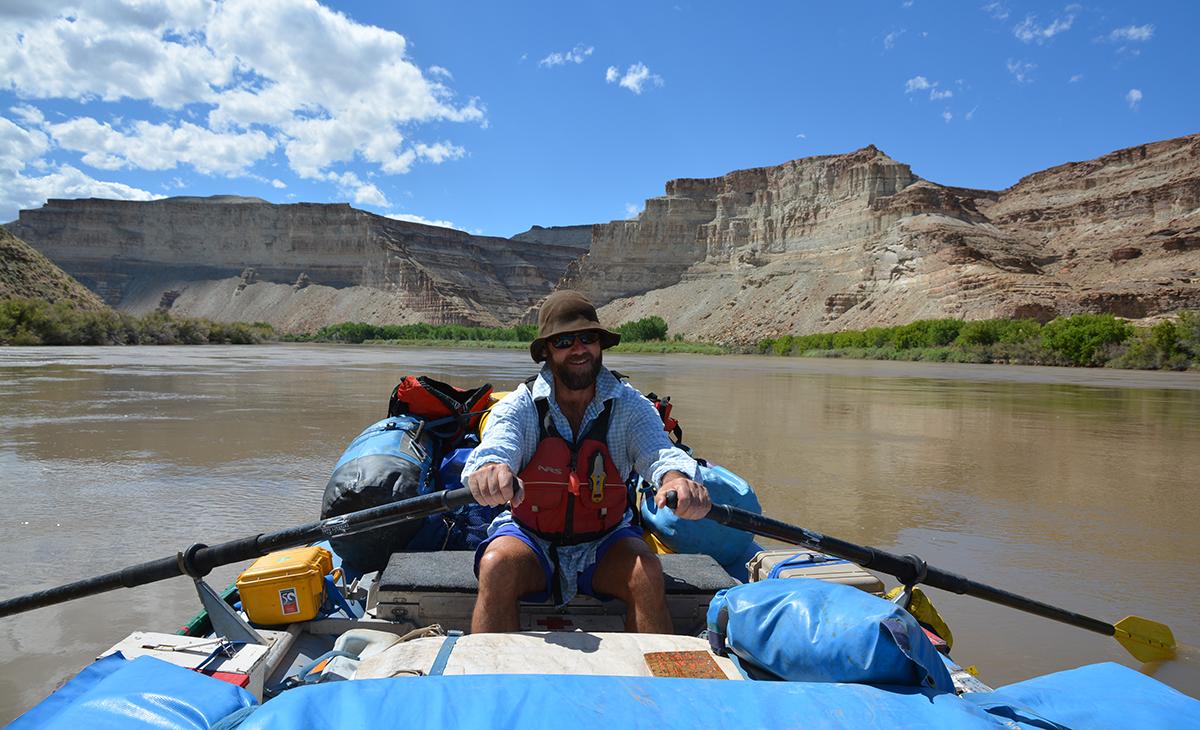A river ranger rows a raft down the Gray Canyon.