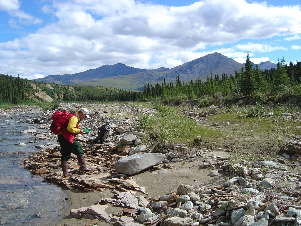 An employee conducts stream research, BLM photo