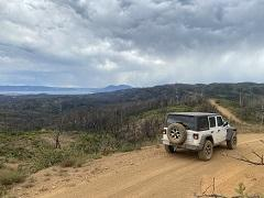Jeep on a high trail overlooking Clear Lake. Photo by Tim Pananos, BLM.
