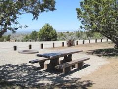 Picnic table in shade overlooking high desert landscape. Photo by the BLM.