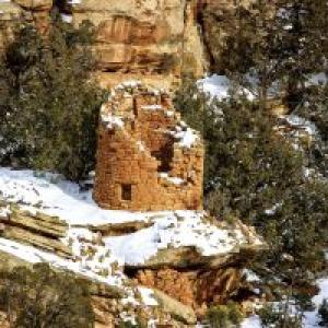 The Painted Hand Pueblo, an Anasazi village inhabited in the 1200s, sits amid the backcountry of Canyons of the Ancients National Monument. The site is named for pictographs of hands painted near its focal point, a large stone tower perched atop a boulder