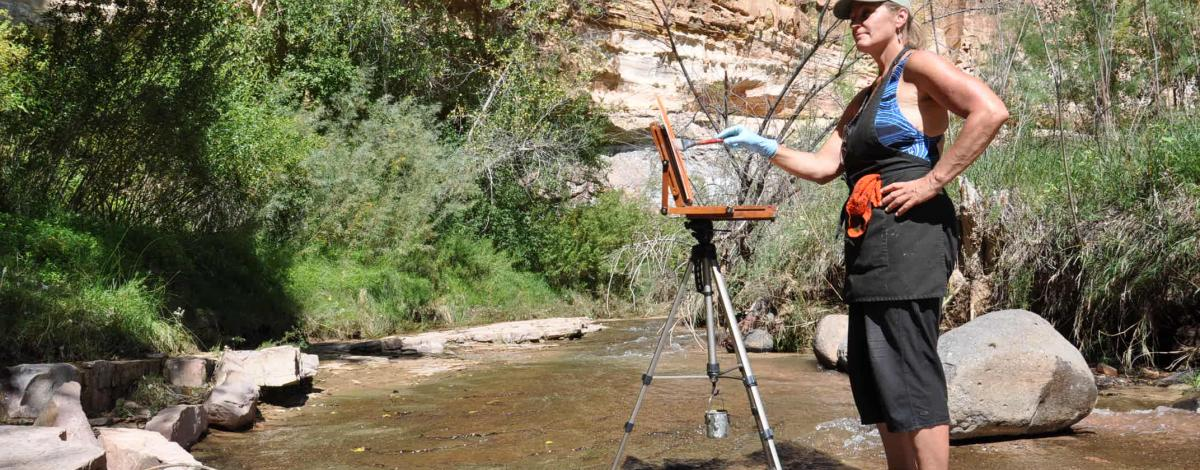 Artist Loretta Domaszewski paints along the Escalante River.
