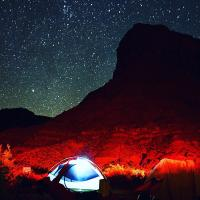 A tent is lit up by lamps in the Big Bend Campground outside Moab, Utah.