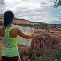 A woman looks at her map in Cedar Mesa.