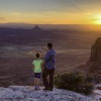 Father and daughter watch the sunset in Utah, thumbnail