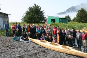 Chugach Alaska Corporation shareholders and descendants gather for a kayak blessing at the Nuchek (Nuuciq)