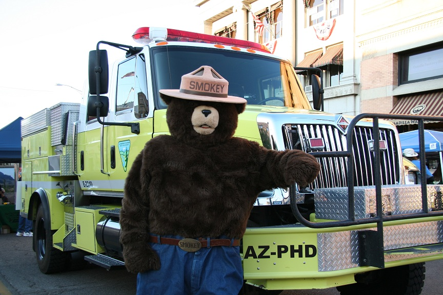Smokey Bear next to a BLM Fire Engine