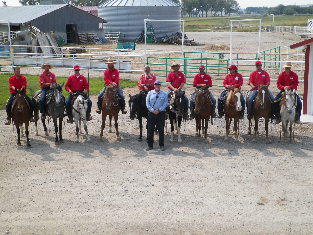 Inmates on their horses in a row.